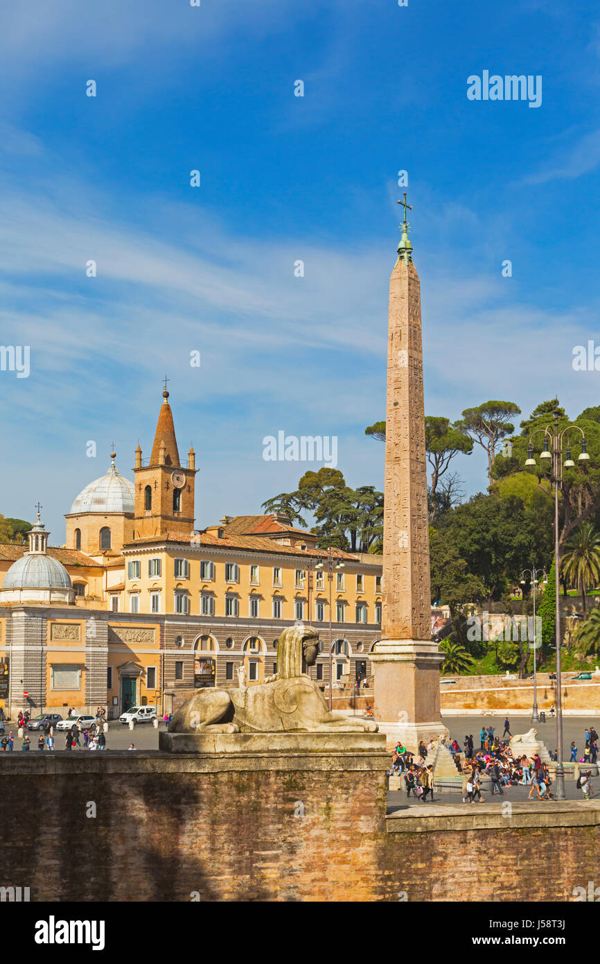 Rome, Italy.   Piazza del Popolo.  The obelisk was brought from Heliopolis, Egypt during the reign of the Emperor - Stock Image