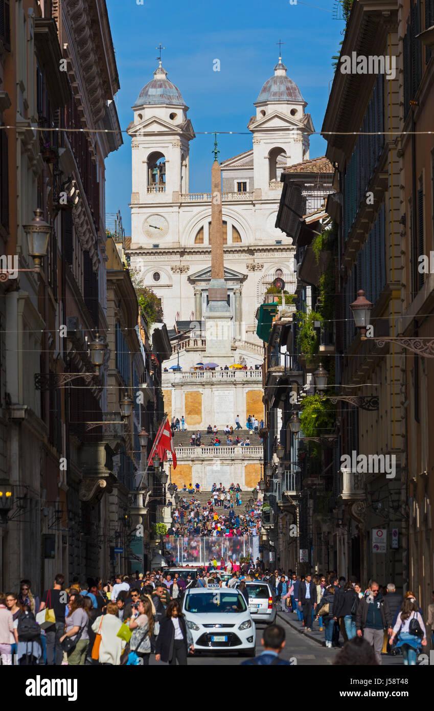 Rome, Italy.  View along Via dei Condotti to the Piazza di Spagna and the church of Trinita dei Monti. - Stock Image