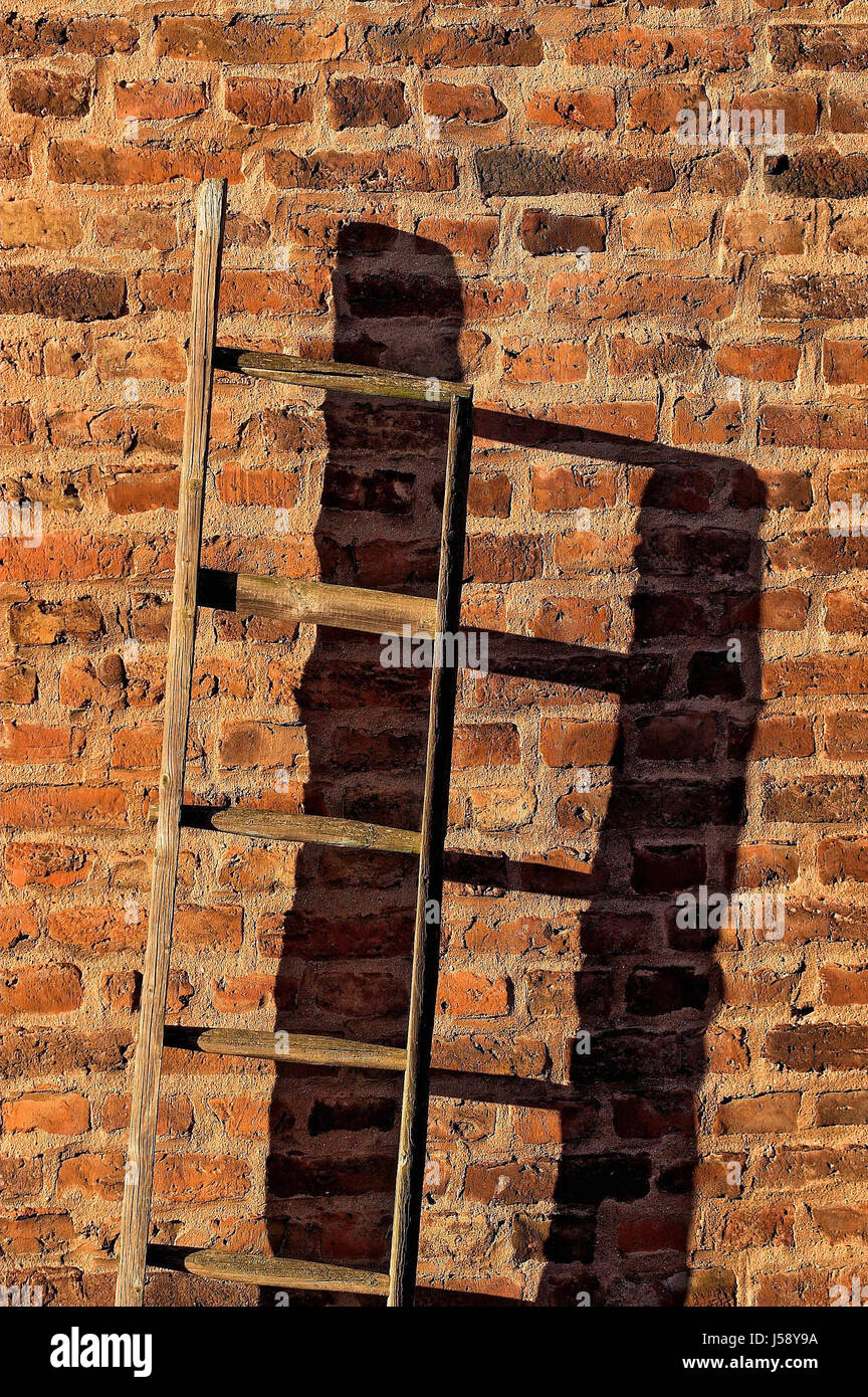 house building wall shadow play ascent staircase rotten bricks shaddow shadow Stock Photo