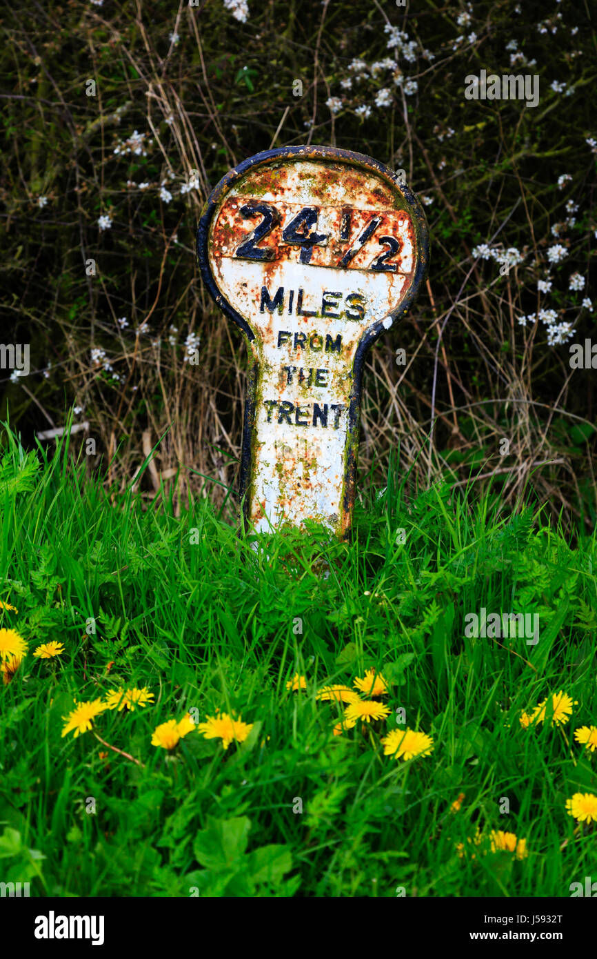 Canal mile marker on the banks of the Grantham to Nottingham near Redmile, Lincolnshire, canal. Shows 24 1/2 miles - Stock Image