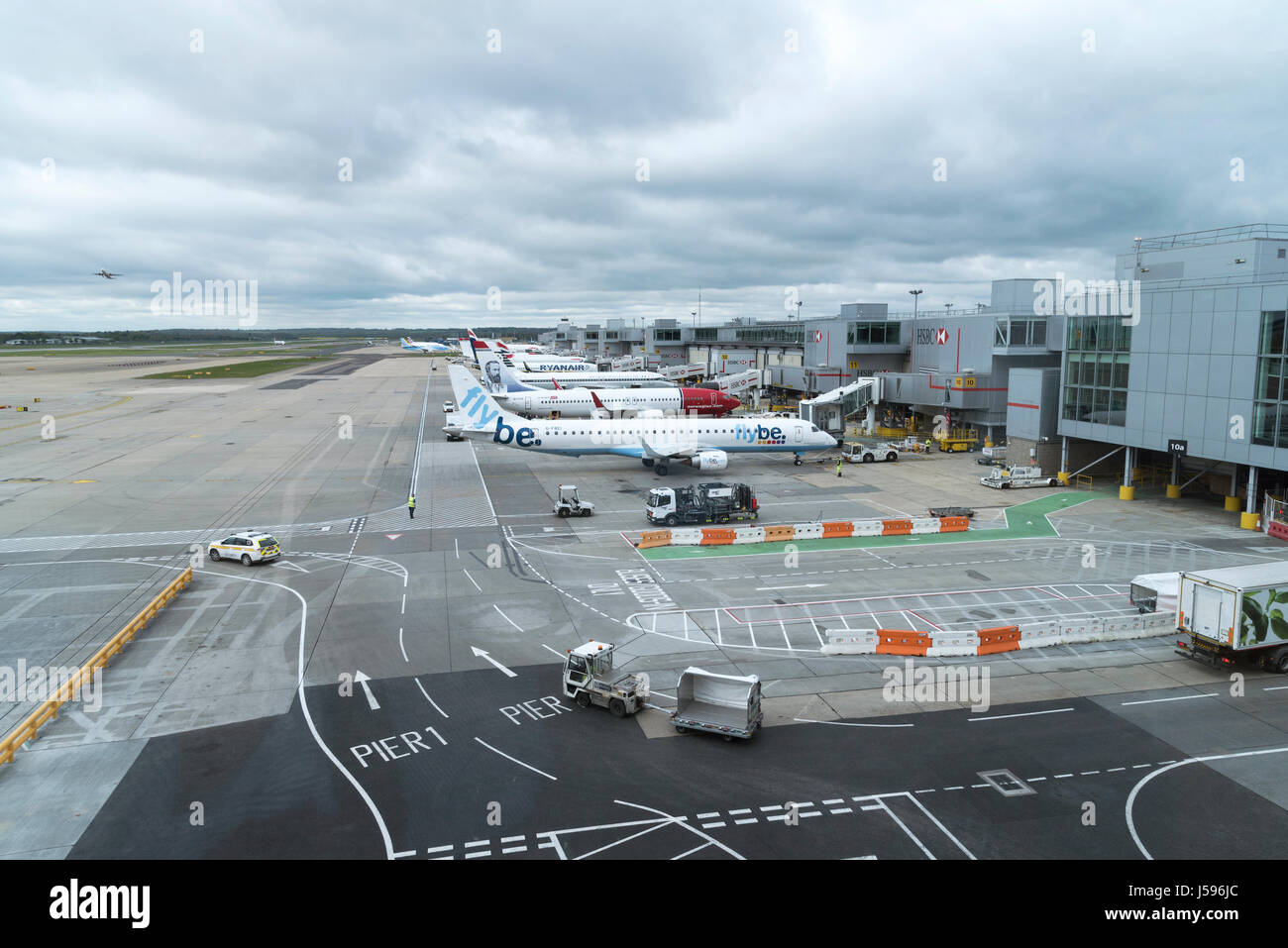 Aircraft movements on a overcast morning at the South terminal London Gatwick airport England UK. April 2017 - Stock Image