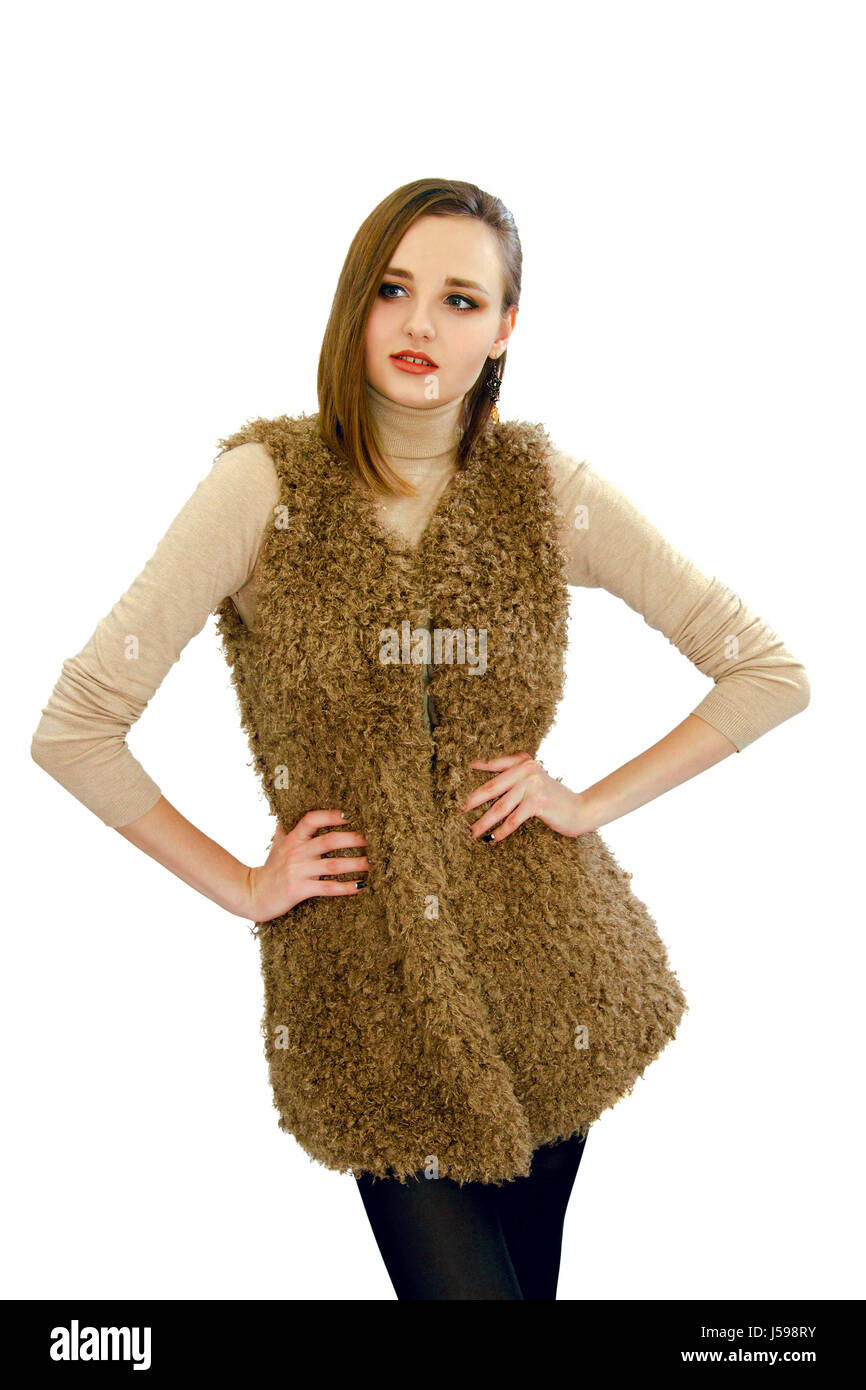 An image of a beautiful young girl in a vest an artificial fur - Stock Image