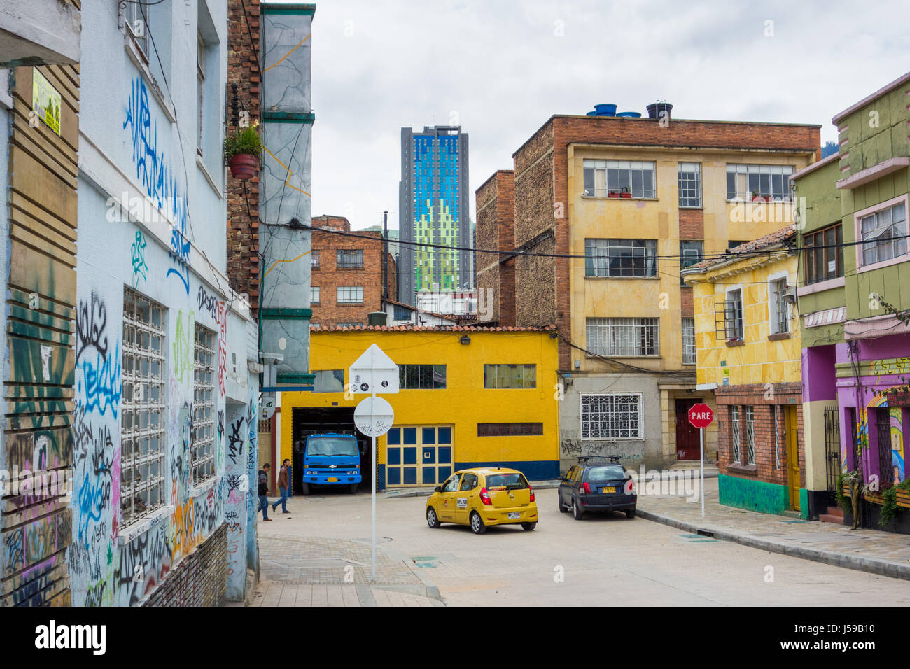 A taxi turns a corner in La Candelaria in Bogota, Colombia - Stock Image