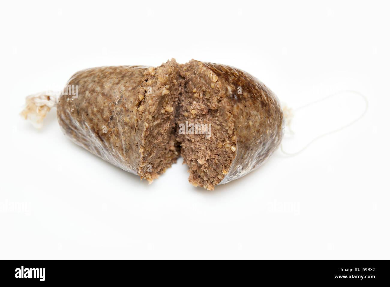 Cooked Scottish haggis isolated on a white studio background. - Stock Image