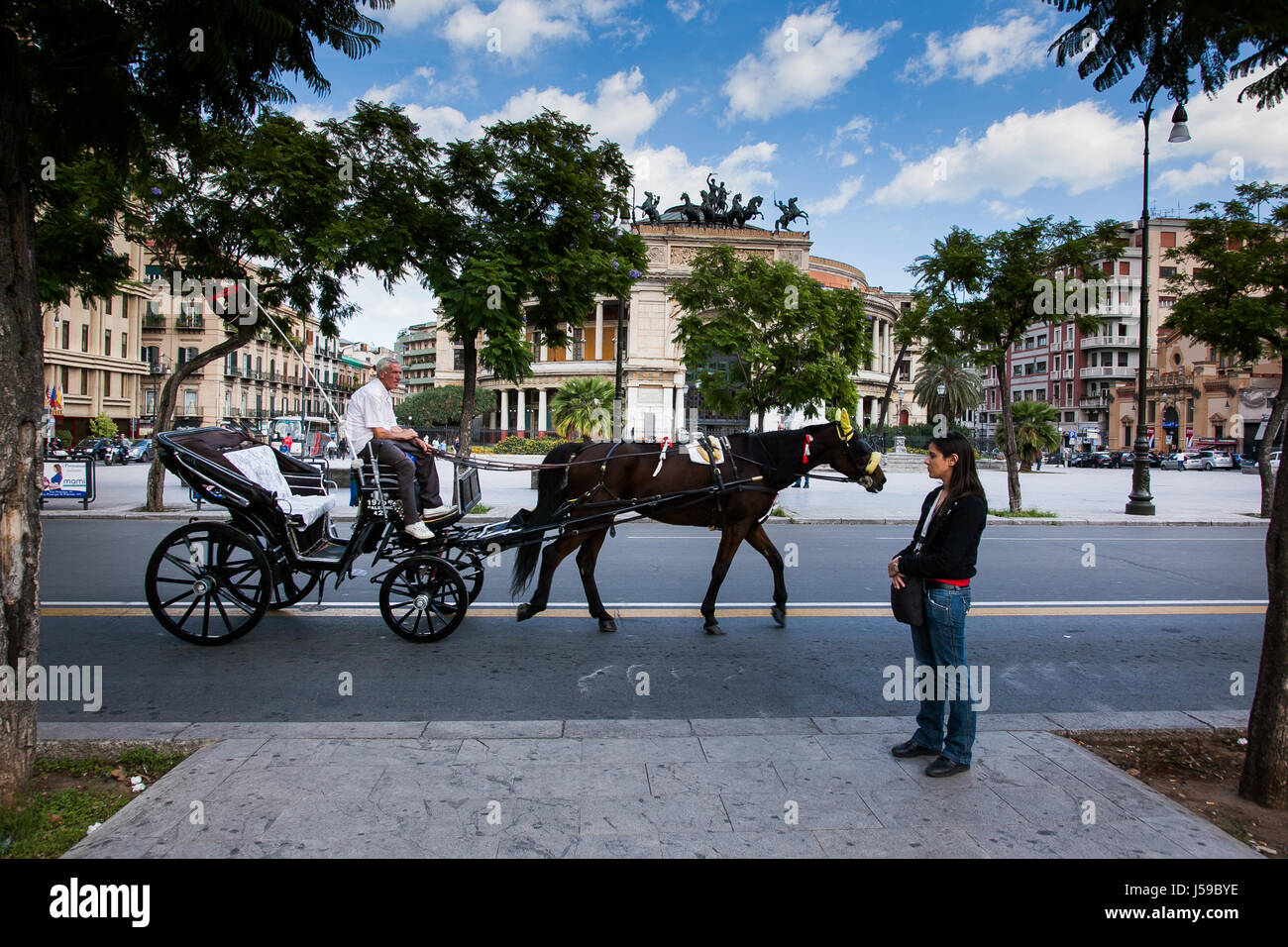 PALERMO, ITALY - October 14, 2009: The Politeama Garibaldi theater in Palermo, Sicily, horse cart Stock Photo