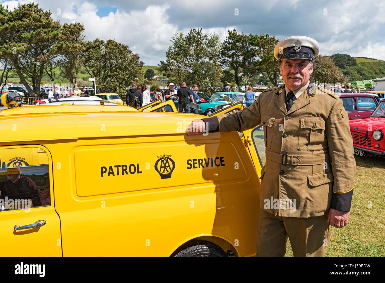 a 1960's AA patrol man and a patrol service mini van, at he cornish min car club show at pentewan in cornwall, uk. Stock Photo