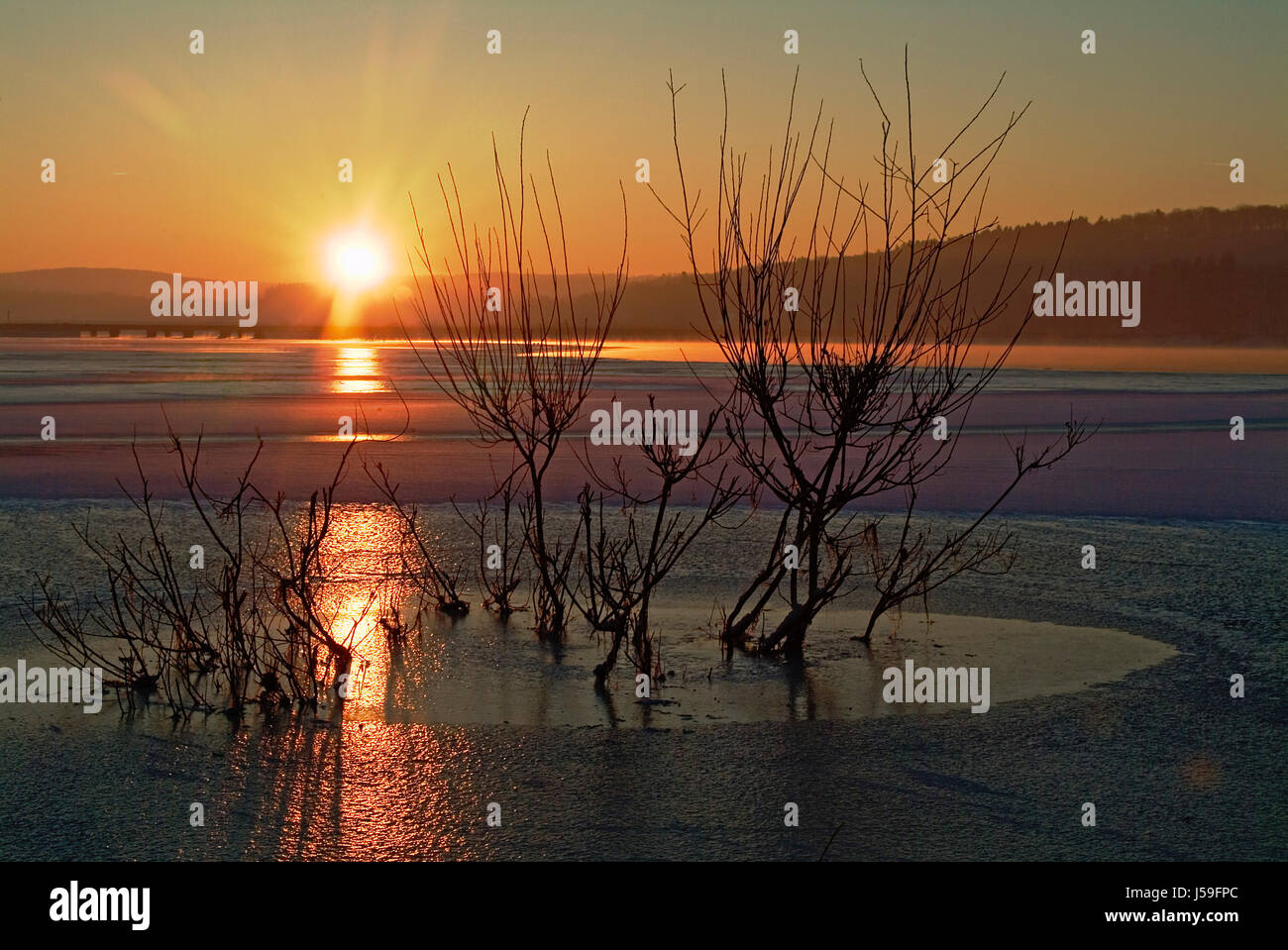 sunset mood ice colour orange colors colours shine shines bright lucent light Stock Photo