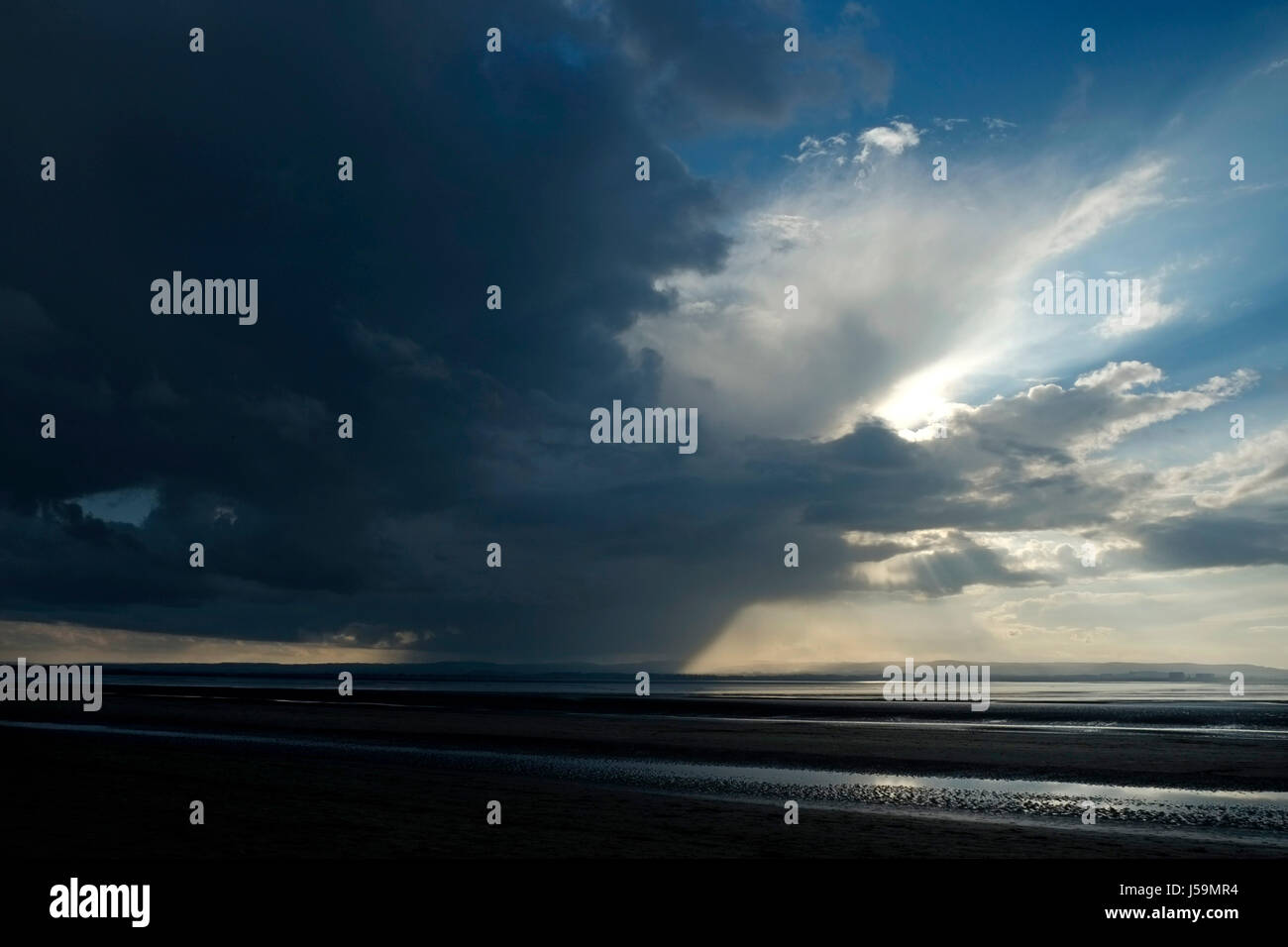 A storm over Hinkley  Point  nuclear power station in the Severn Estuary, approaching Burnham-on-Sea, Somerset, - Stock Image