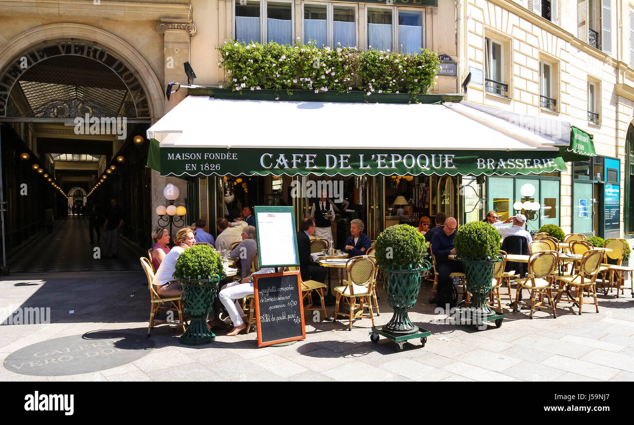 The View of typical paris cafe in the quarter of commercial Bourse in Paris, France - Stock Image