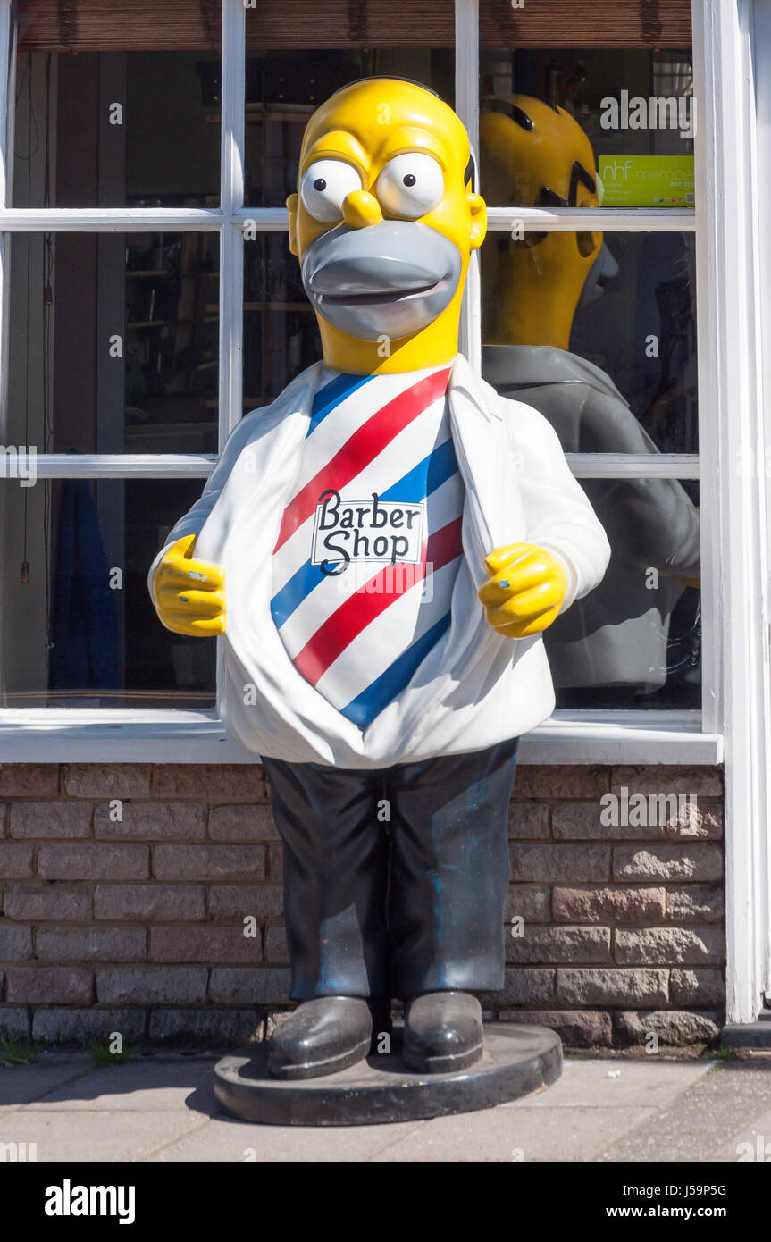 'Bart Simpson' character barber shop sign, High Street, Ewell, Surrey, England, United Kingdom - Stock Image