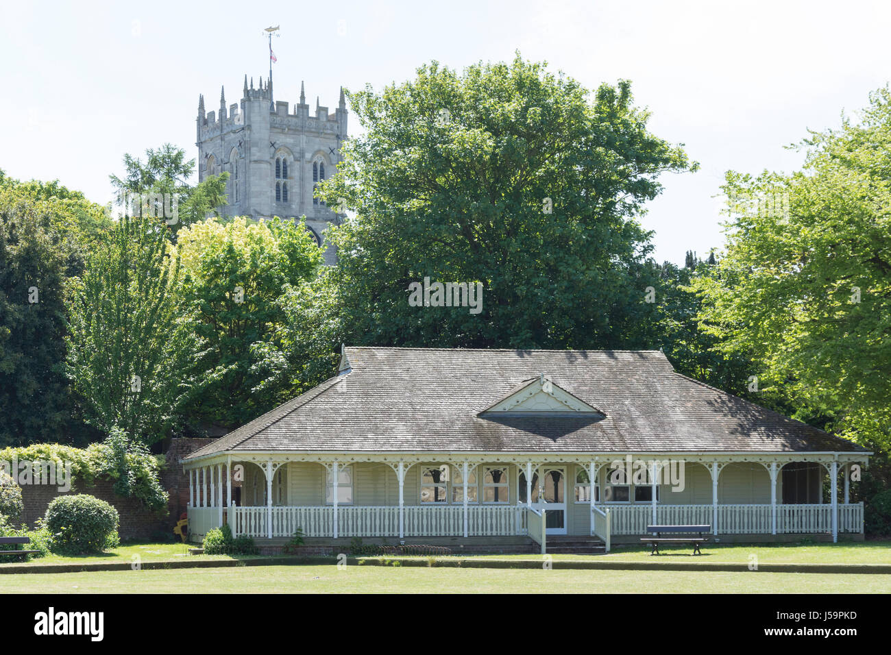 Kings Arms Bowling Pavilion and Christchurch Priory, Castle Street, Christchurch, Dorset, England, United Kingdom - Stock Image