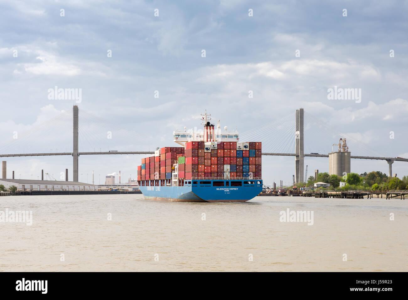 Savannah, GA - March 27, 2017:  Container ship approaching the Talmadge Memorial Bridge on the Savannah River as - Stock Image