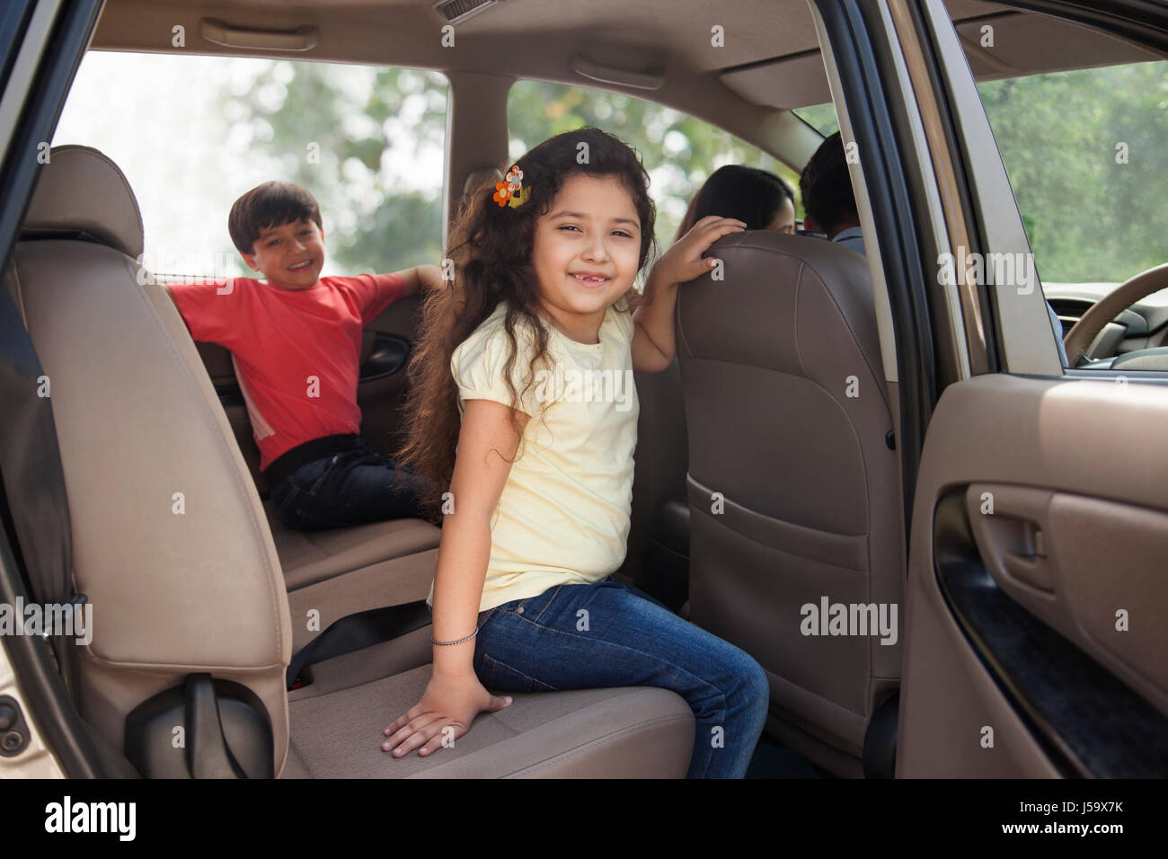 Cute Girl And Boy Sitting In Car Back Seat Stock Photo Alamy