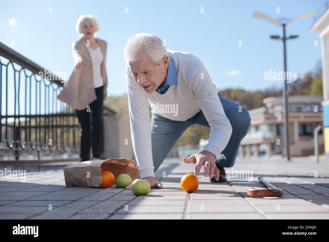 old-man-falling-down-in-the-street-J59XJN.jpg