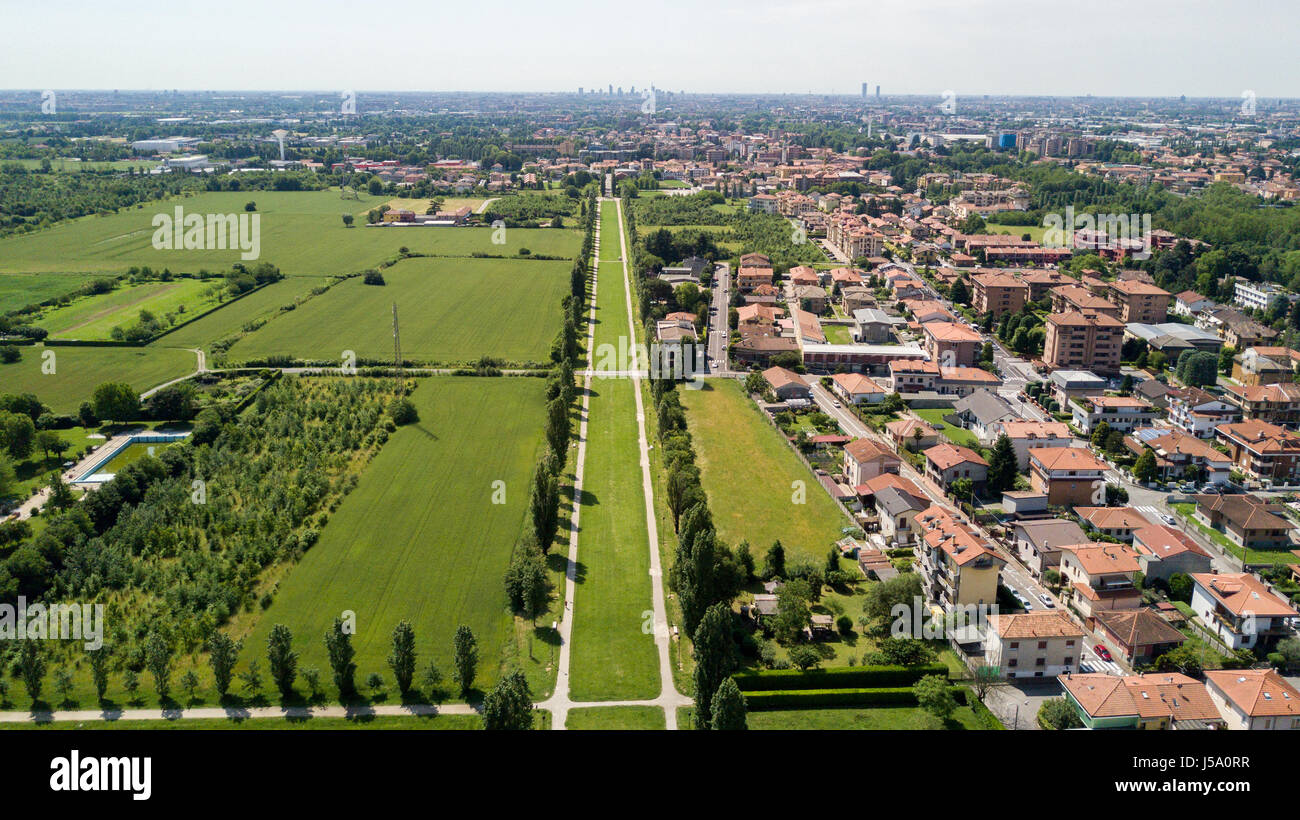 New Skyline of Milan seen from the Milanese hinterland, aerial view, tree lined avenue. Pedestrian cycle path. Varedo, - Stock Image