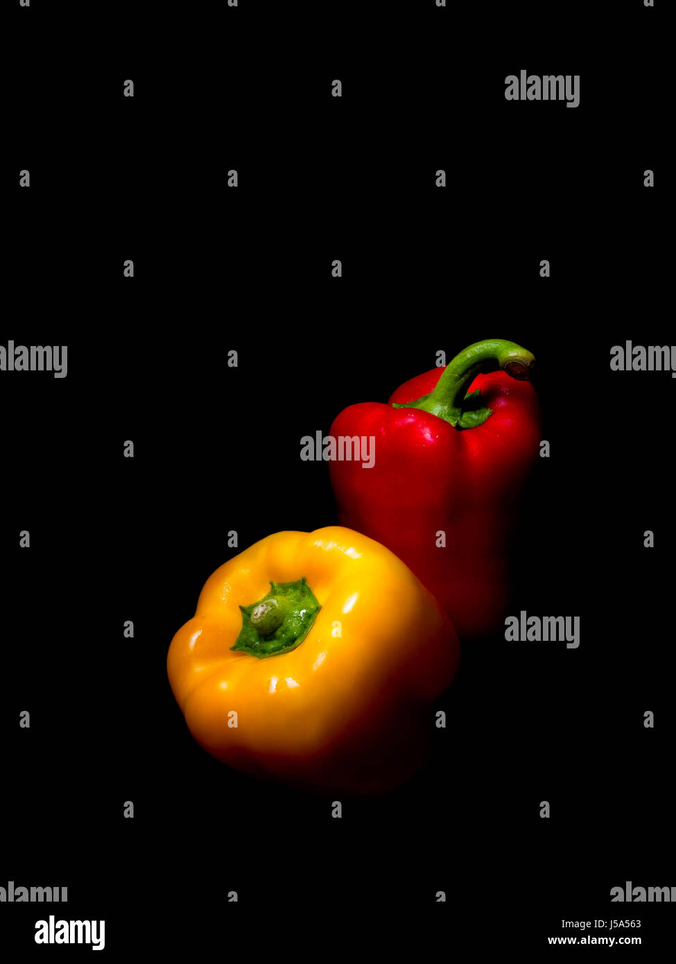 Sweet peppers on black. Dramatic studio shot. Stock Photo
