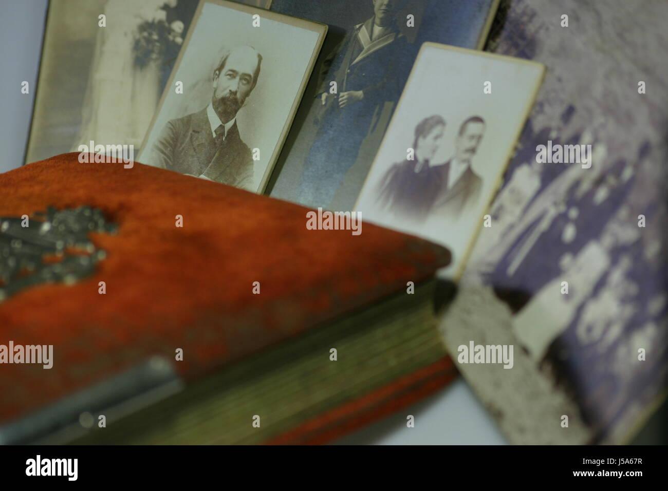 antique nostalgia nostalgic memories forefathers photos memory album genealogy Stock Photo