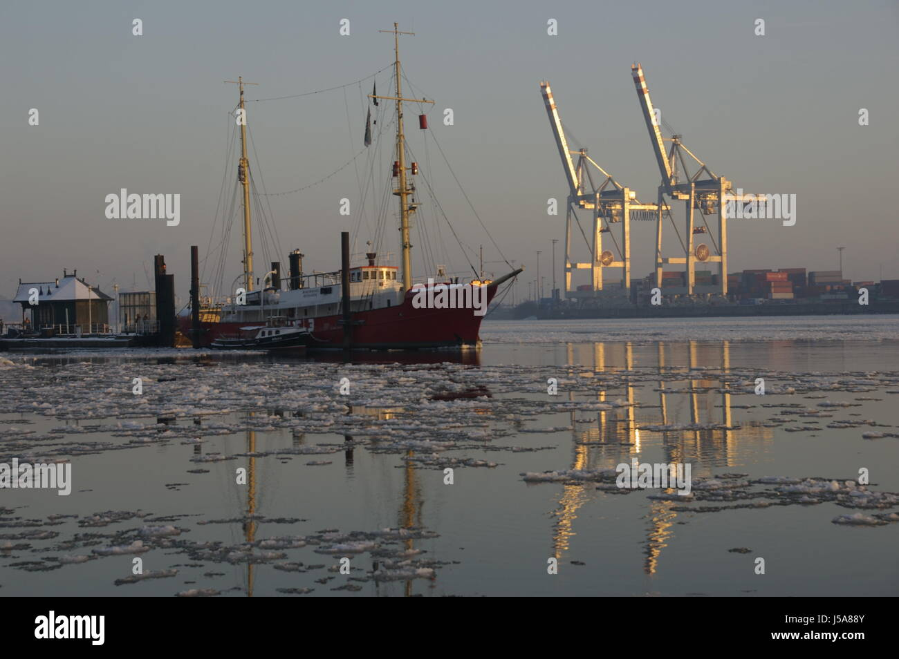 new contrast harbor evening tendency hamburg harbours elbe old feuerwehrschiff Stock Photo