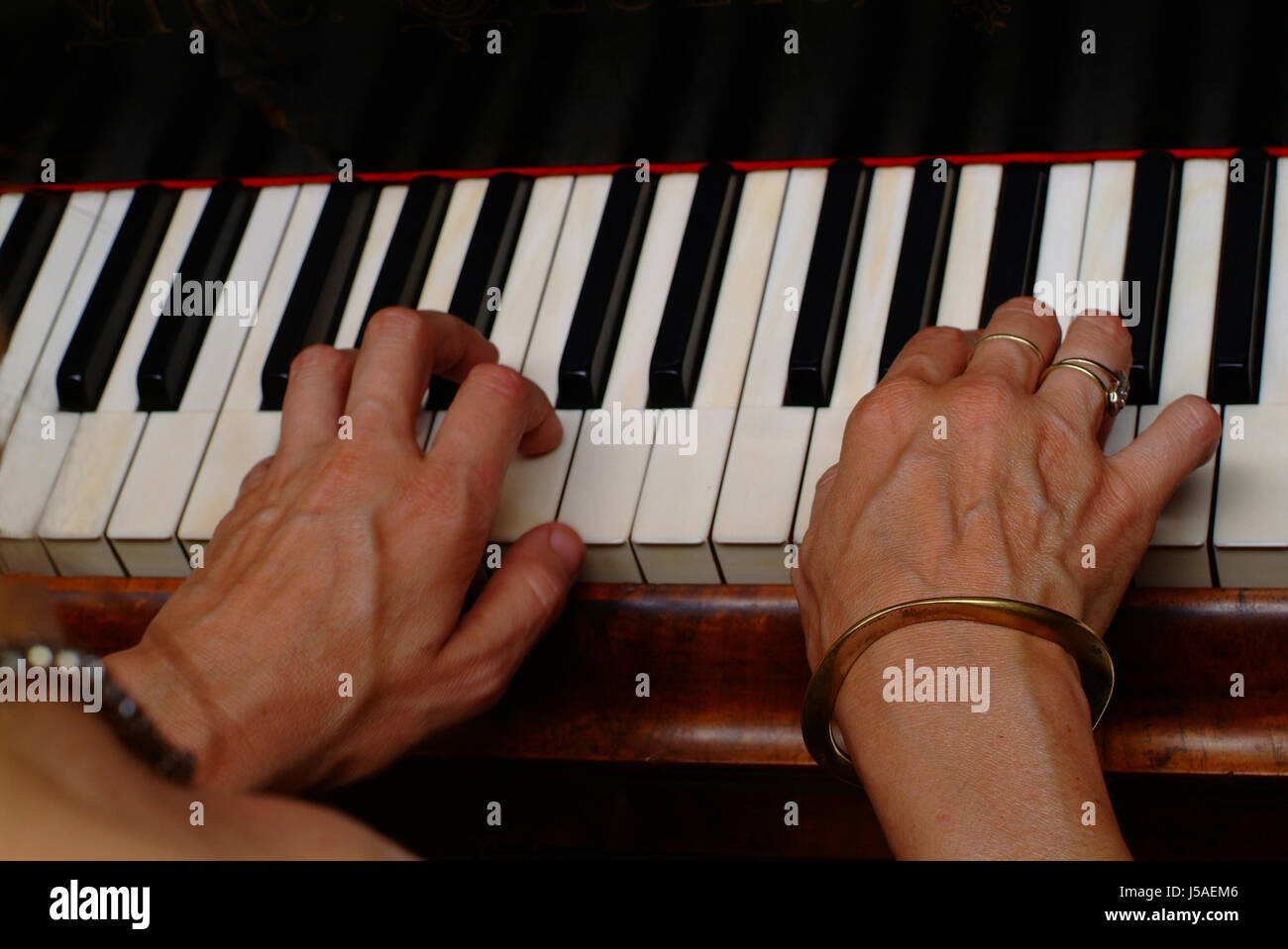 Music Keyboard Woman Stock Photos & Music Keyboard Woman