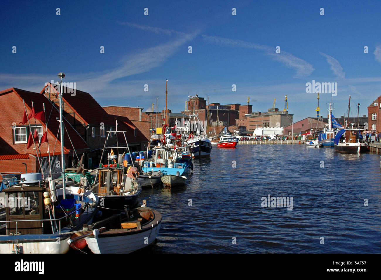 blue houses city town waters ships sailing boat sailboat rowing boat boat - Stock Image