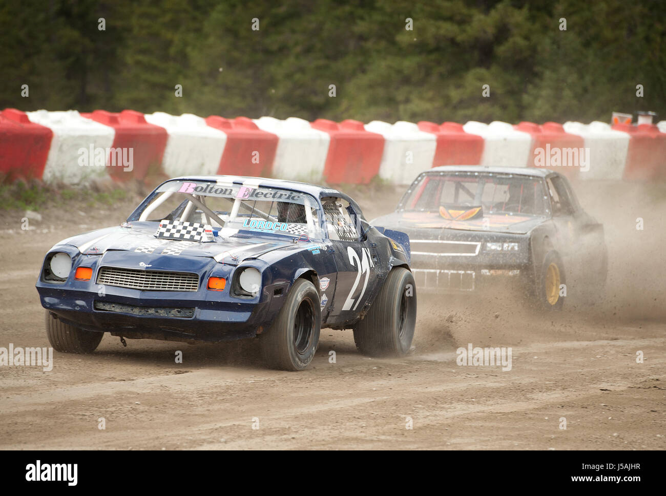 Small town dirt track stock car racing.  Home made race cars on a dirt track.  Pemberton BC, Canada - Stock Image