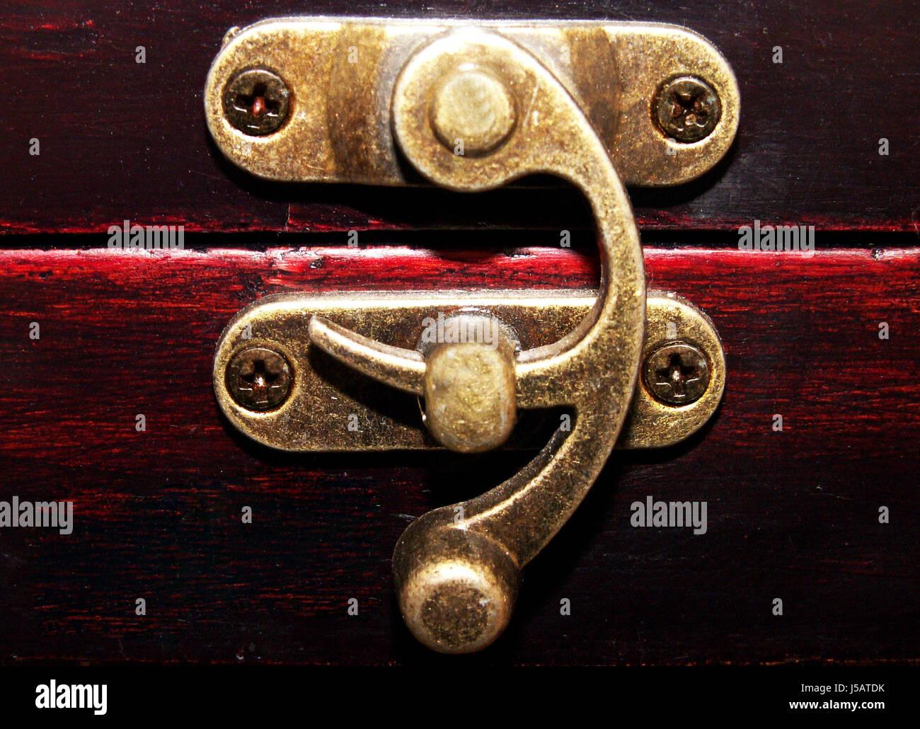 closed lever bolt screwed on brass-colour verschlu metallverschlu - Stock Image