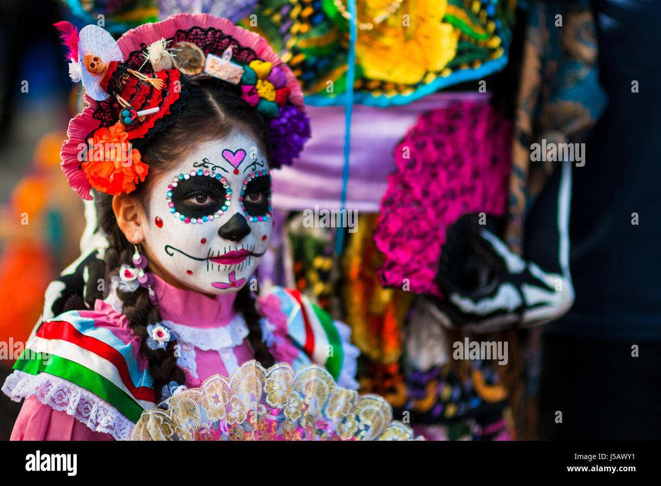 A Young Girl Dressed As La Catrina Takes Part In The Day Of The