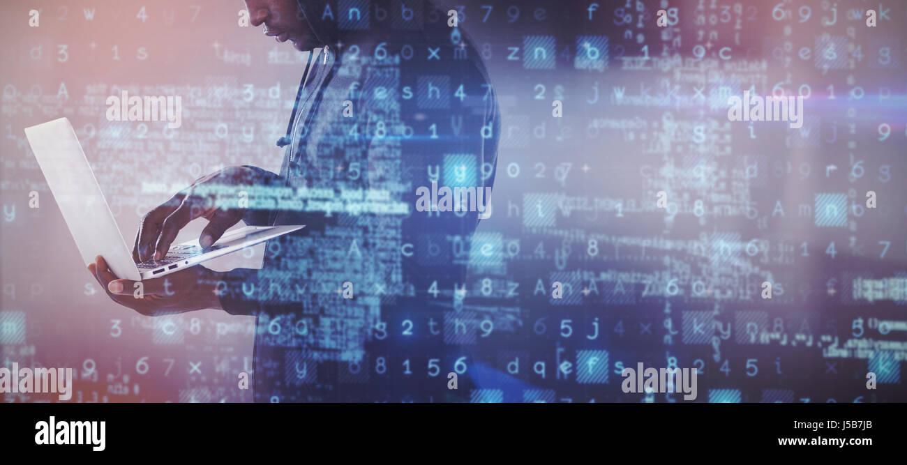 Hacker using a laptop against white tile design - Stock Image