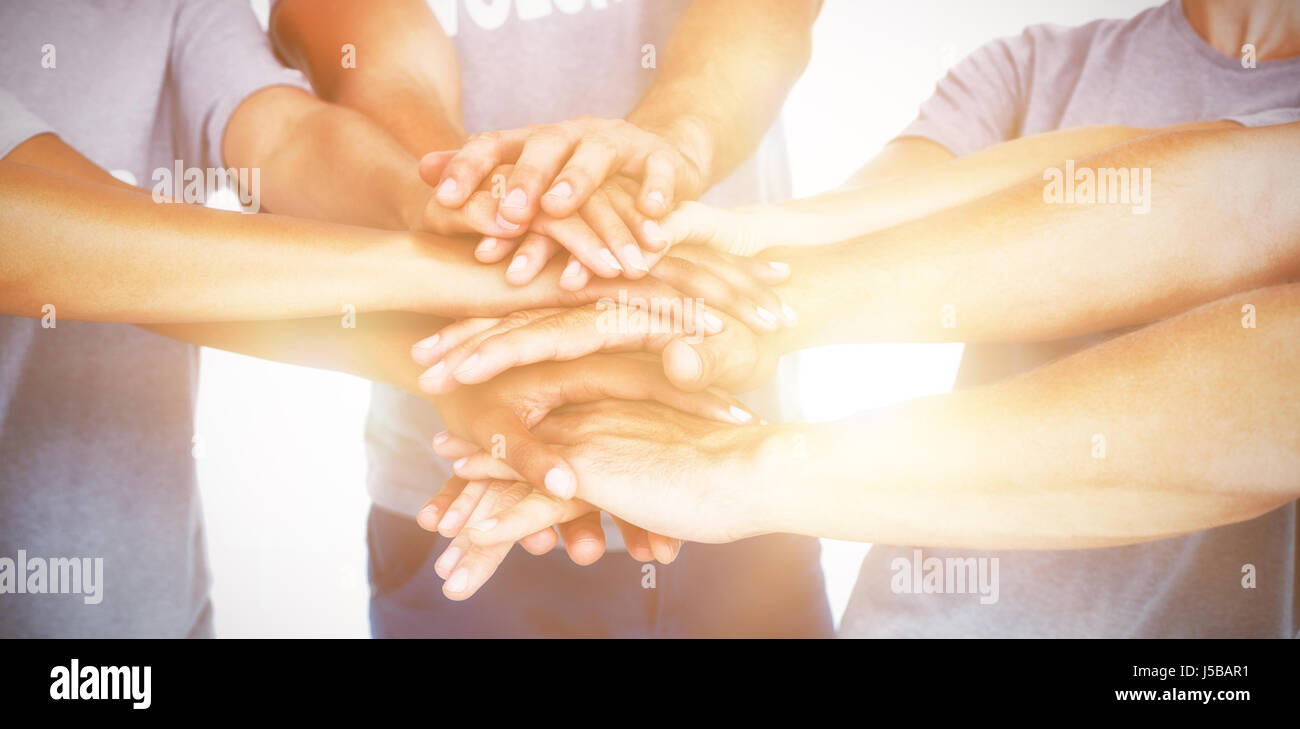 United team grouping their hands - Stock Image