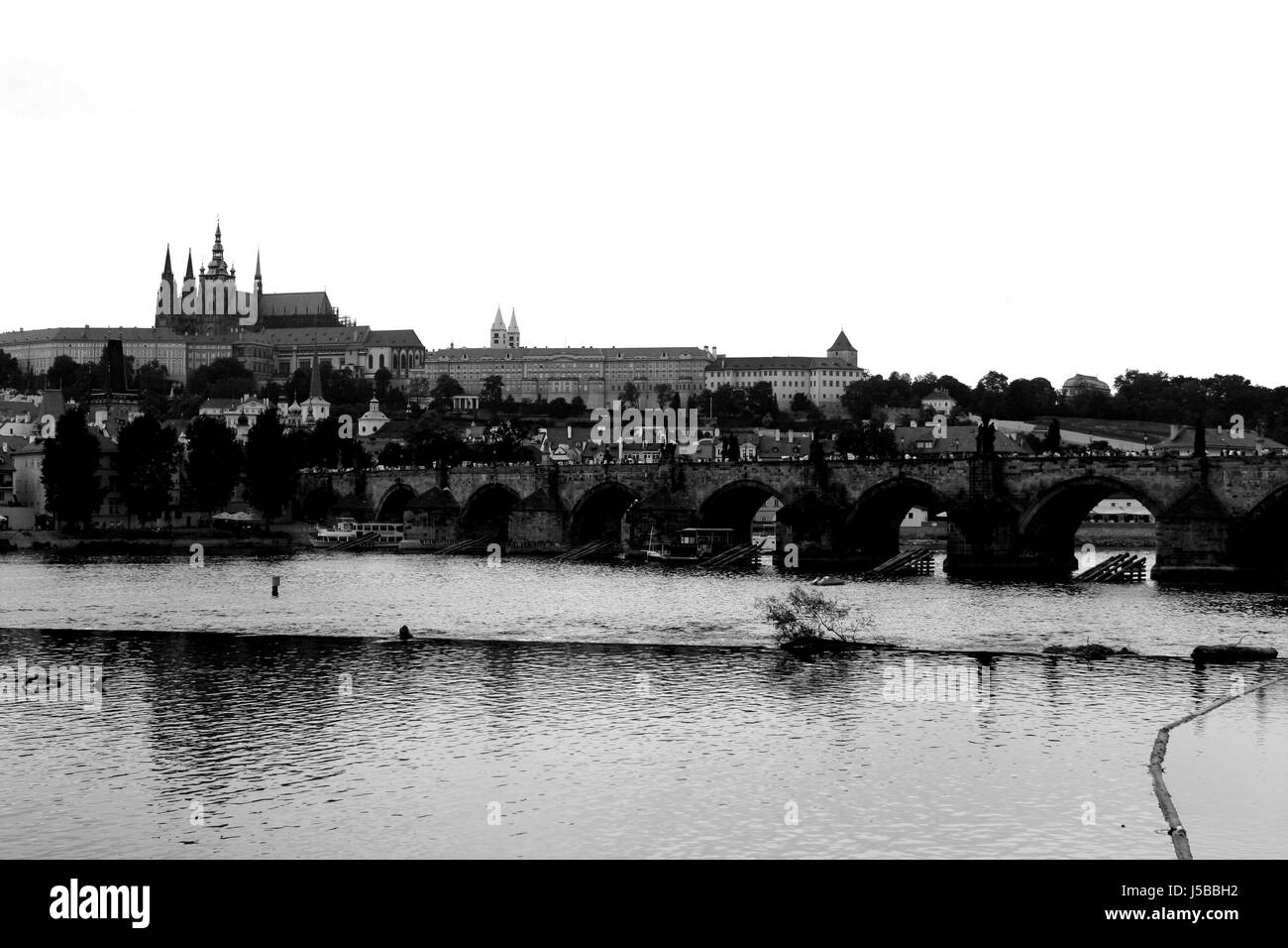 city,town,cathedral,bw,prague,river,water,black and white,karlsbrcke,moldau,cz - Stock Image