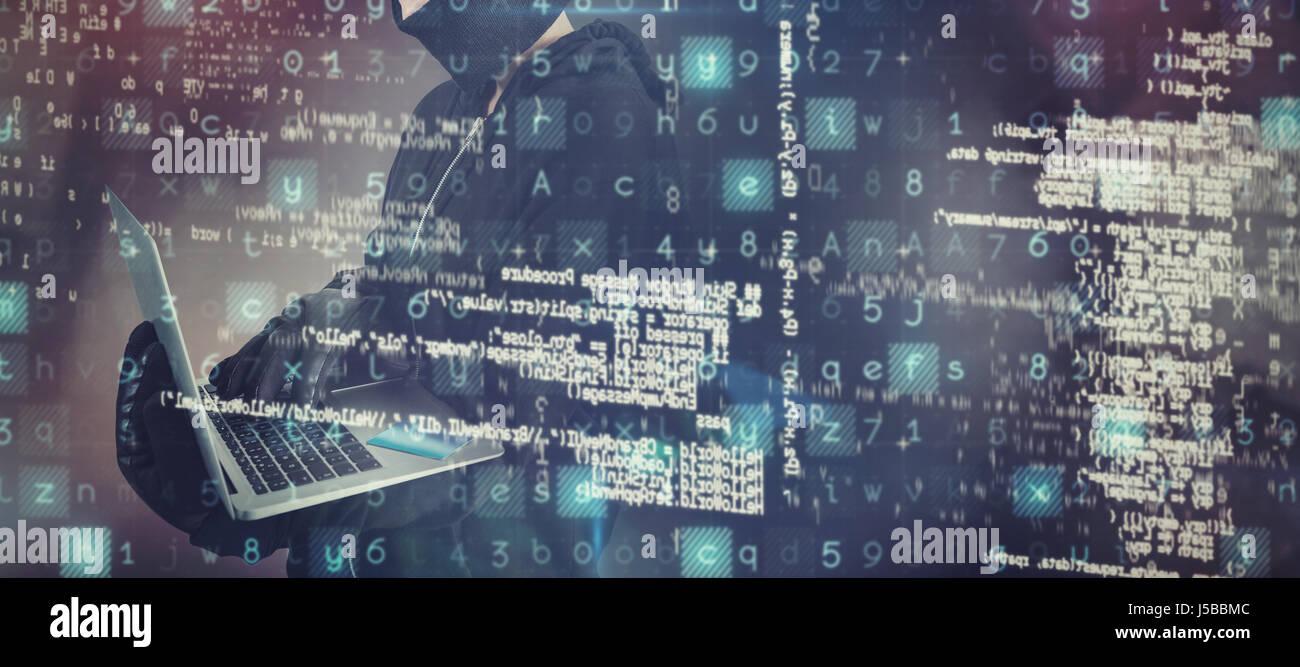 Female hacker using laptop against grey tile design - Stock Image