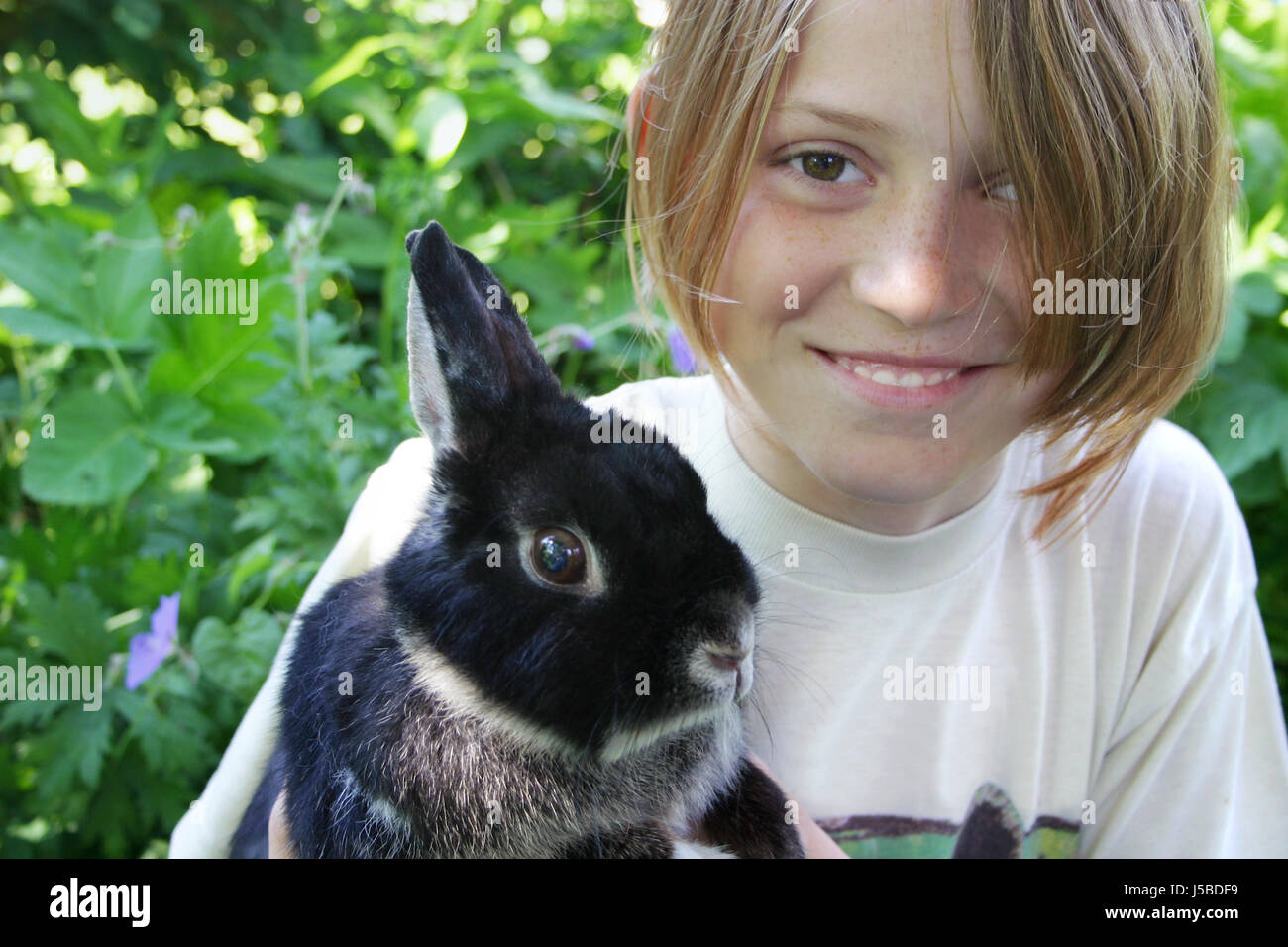 laugh laughs laughing twit giggle smile smiling laughter laughingly smilingly Stock Photo