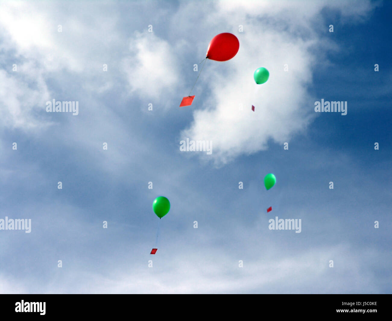 blue balloon competition airmail sender addressee receiver firmament sky child - Stock Image