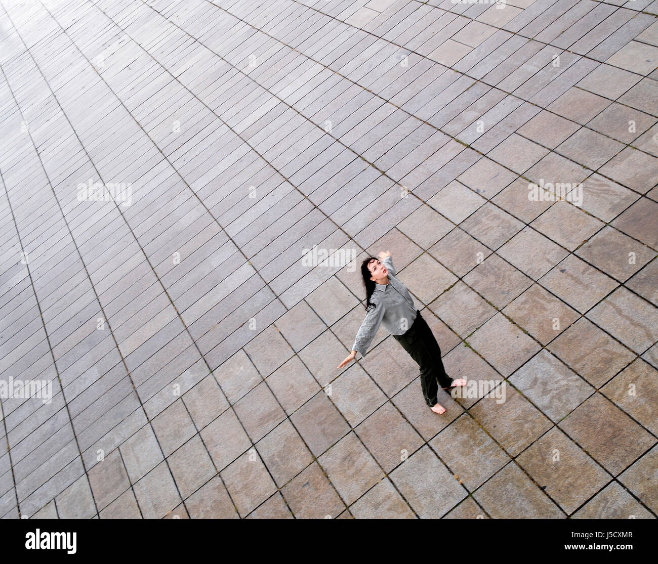 woman green room lost longing plaster freedom liberty perspective prospect Stock Photo