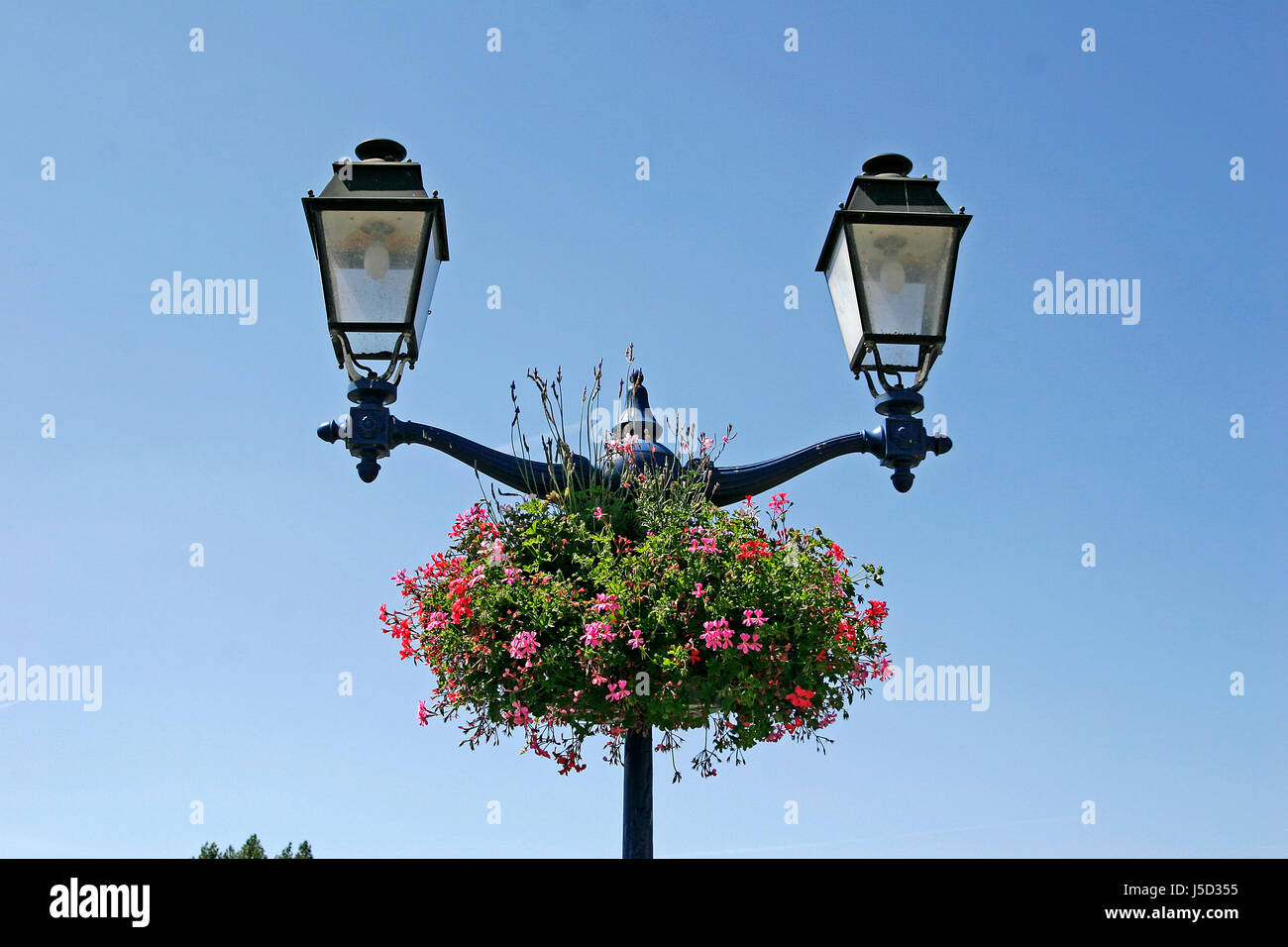 erdeven,streetlight with flowers - Stock Image