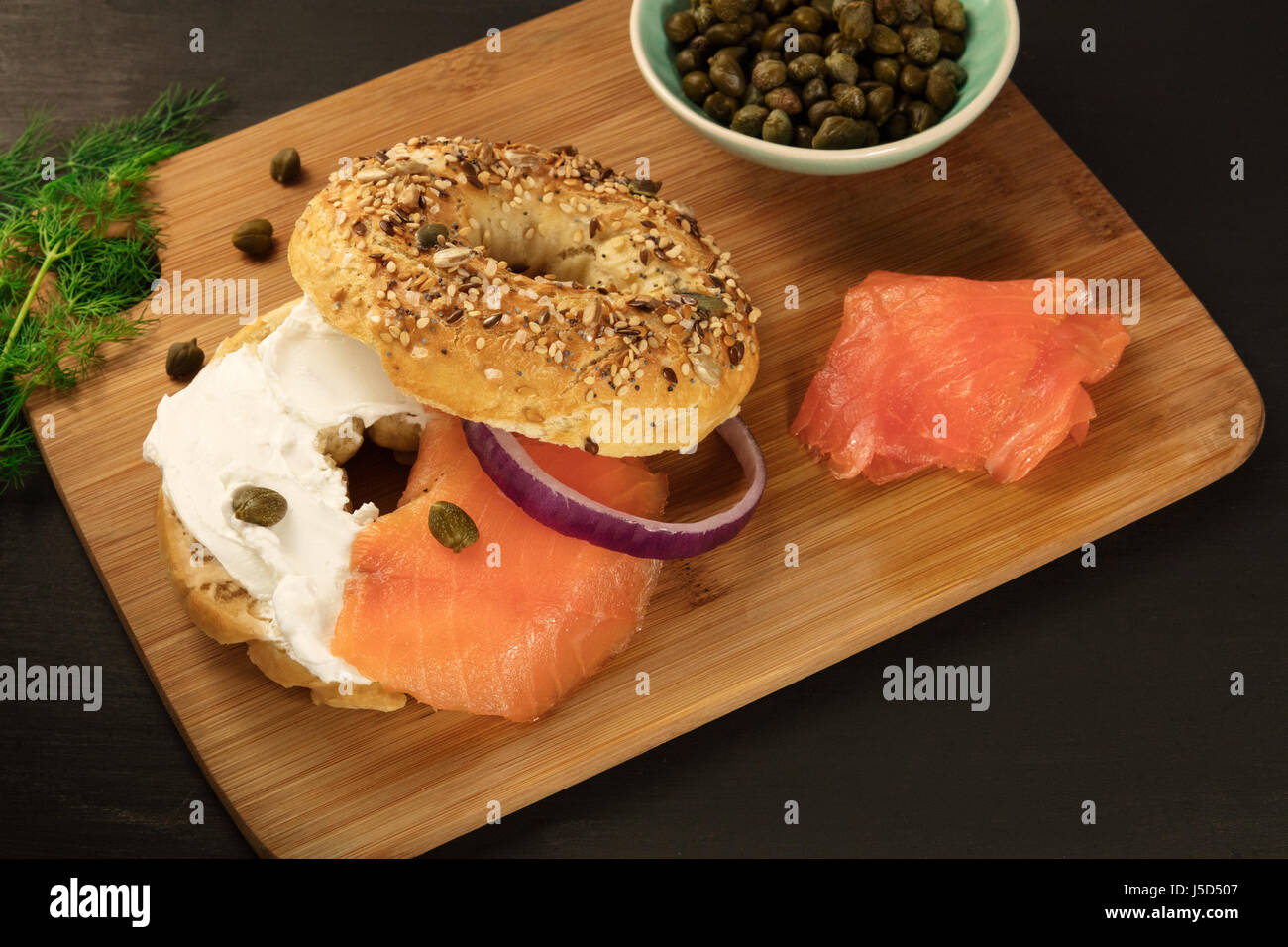 Bagel with cream cheese and lox, place for text - Stock Image