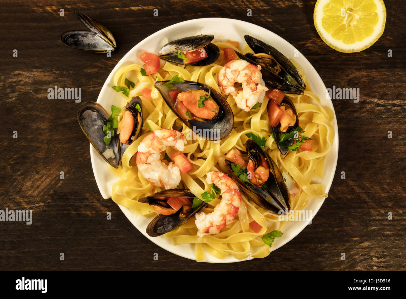 Seafood pasta dish with mussels and shrimps - Stock Image