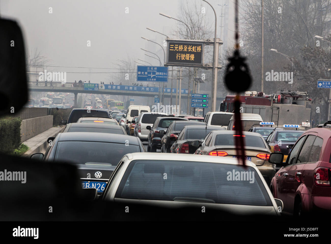 BEIJING, CHINA-CIRCA MARCH 2014:-Rush hour on the inner ring road the traffic crawls through the smog. Stock Photo
