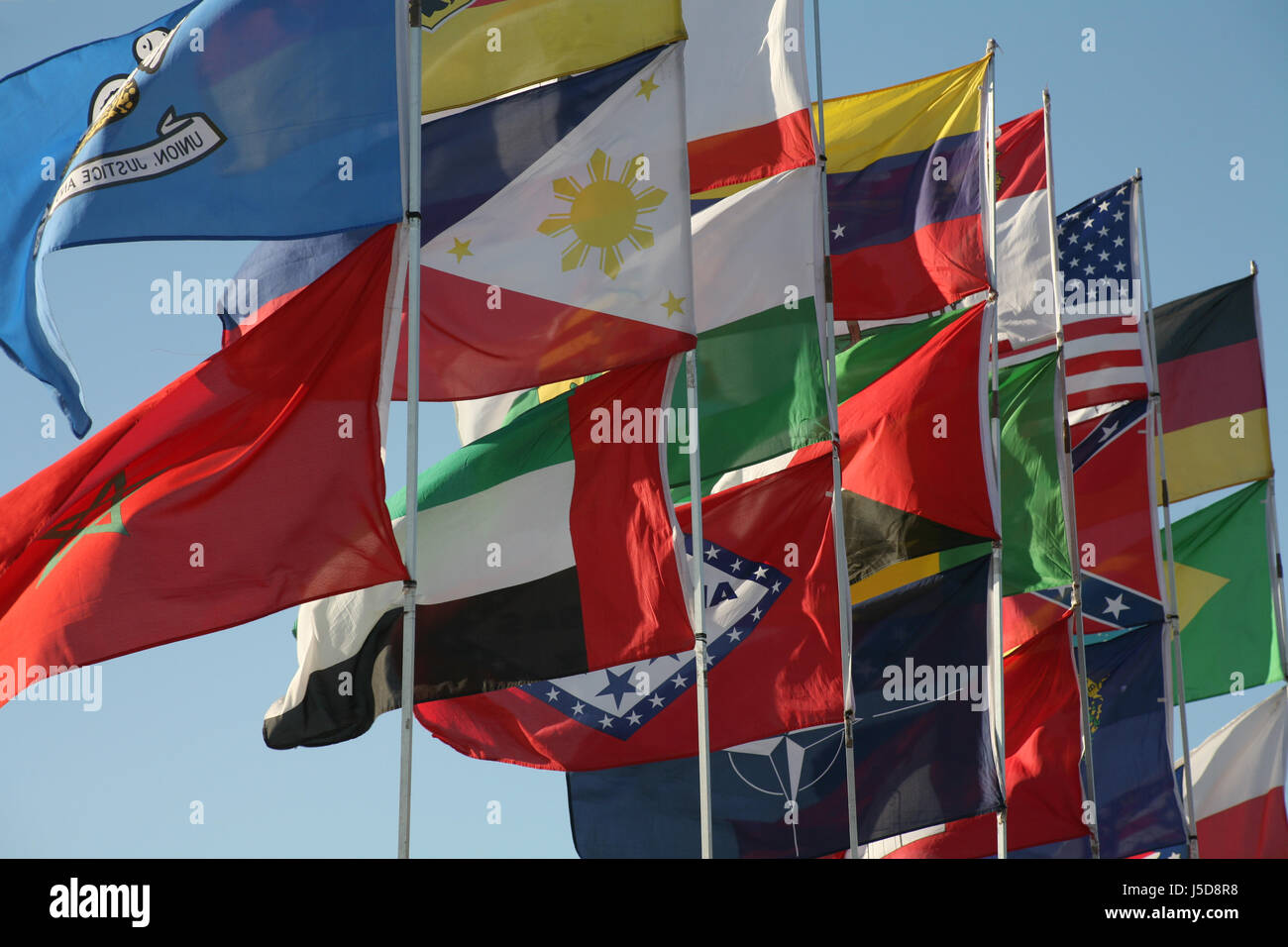 coloured colourful gorgeous multifarious richly coloured masts flags worldwide Stock Photo