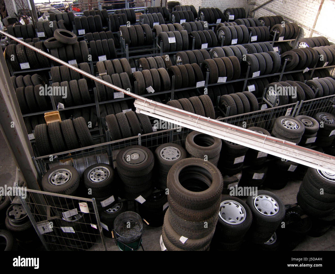 garage camp camp of tents tyre tire tyres profile hall black swarthy jetblack Stock Photo