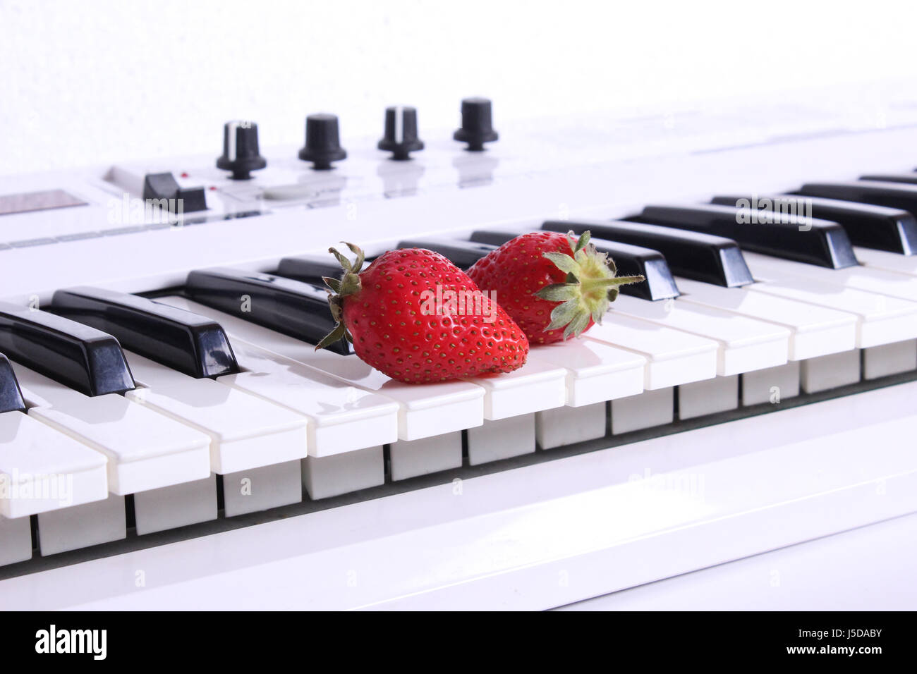 Synthesizer and strawberries - Stock Image