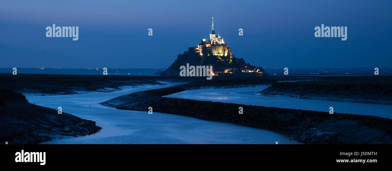 Mont Saint Michel sunset after dark Couesnon river scenic landscape seascape abbey atmospheric gloomy winding river Stock Photo