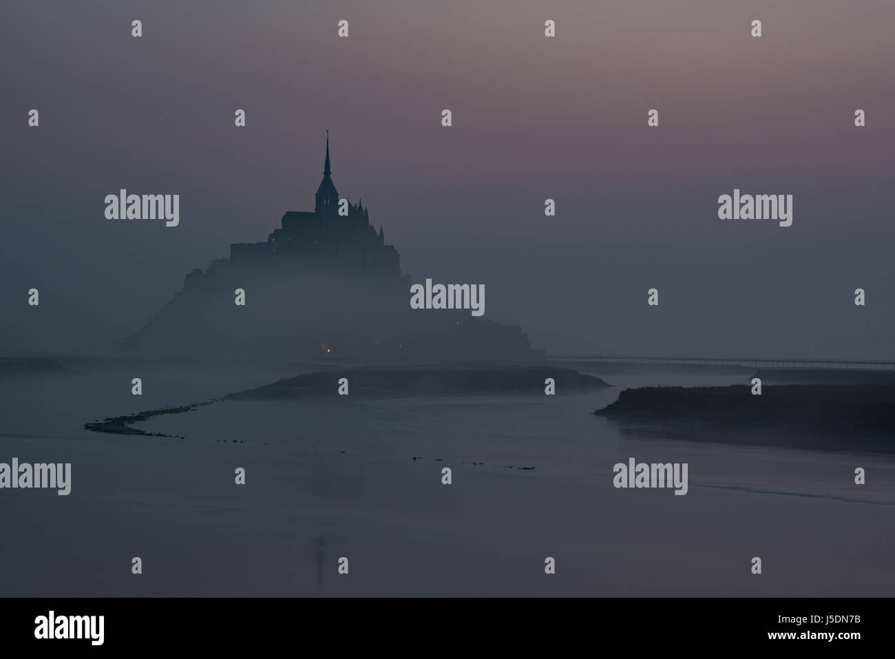 Mont Saint Michel sunrise dawn Couesnon river scenic landscape seascape abbey atmospheric gloomy winding river Mont Stock Photo
