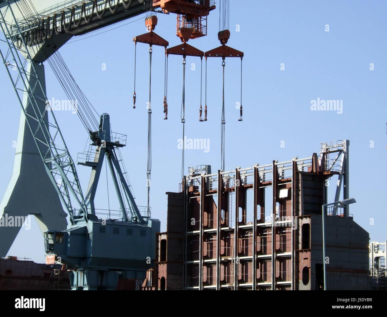 metropolis brown brownish brunette navigation dockyard harbor steel hamburg - Stock Image