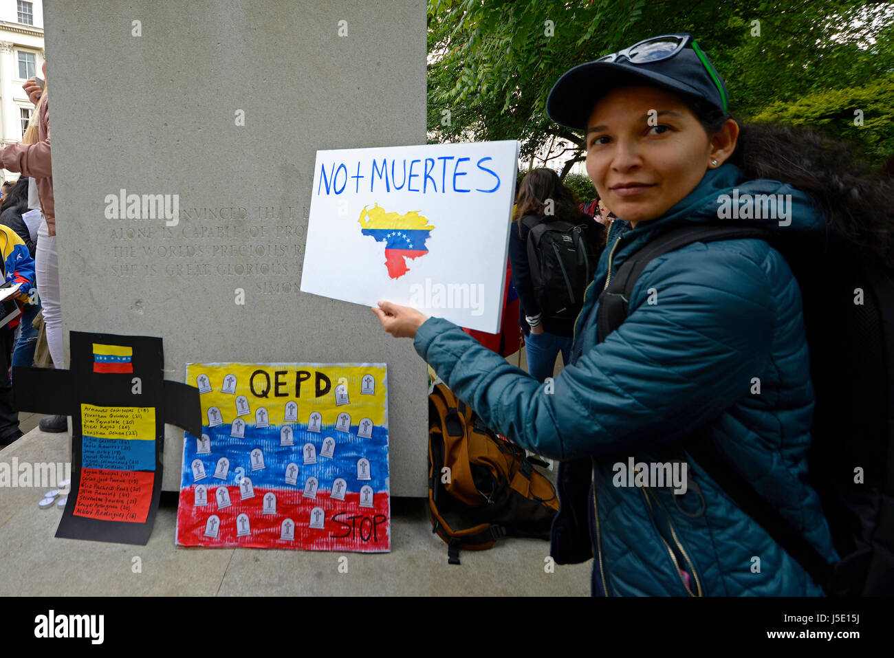 A demonstration protest against Venezuelan dictator Nicolas Maduro took place around the statue of Simon Bolivar - Stock Image