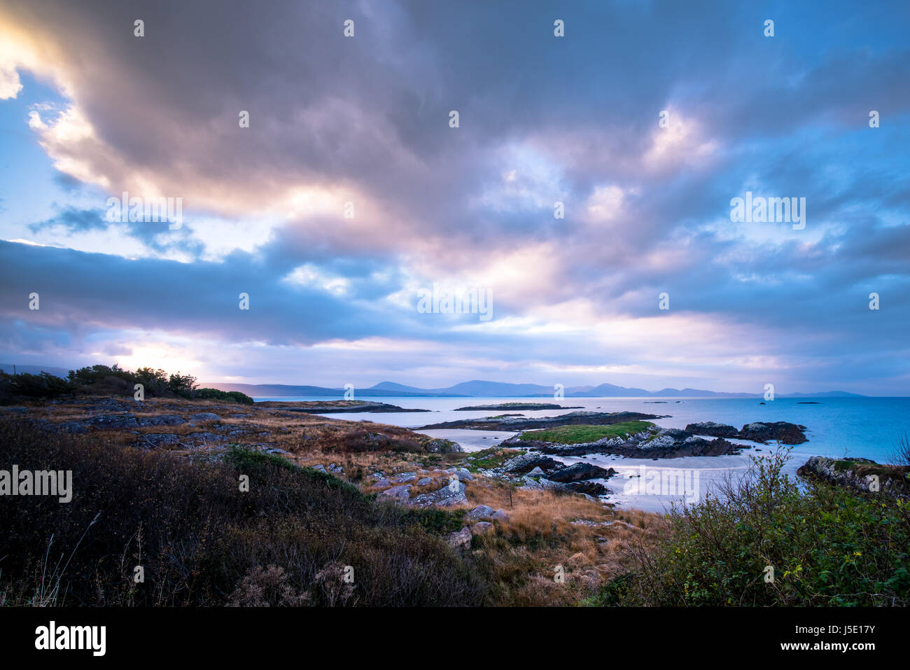 A sunrise over water in County Kerry. - Stock Image
