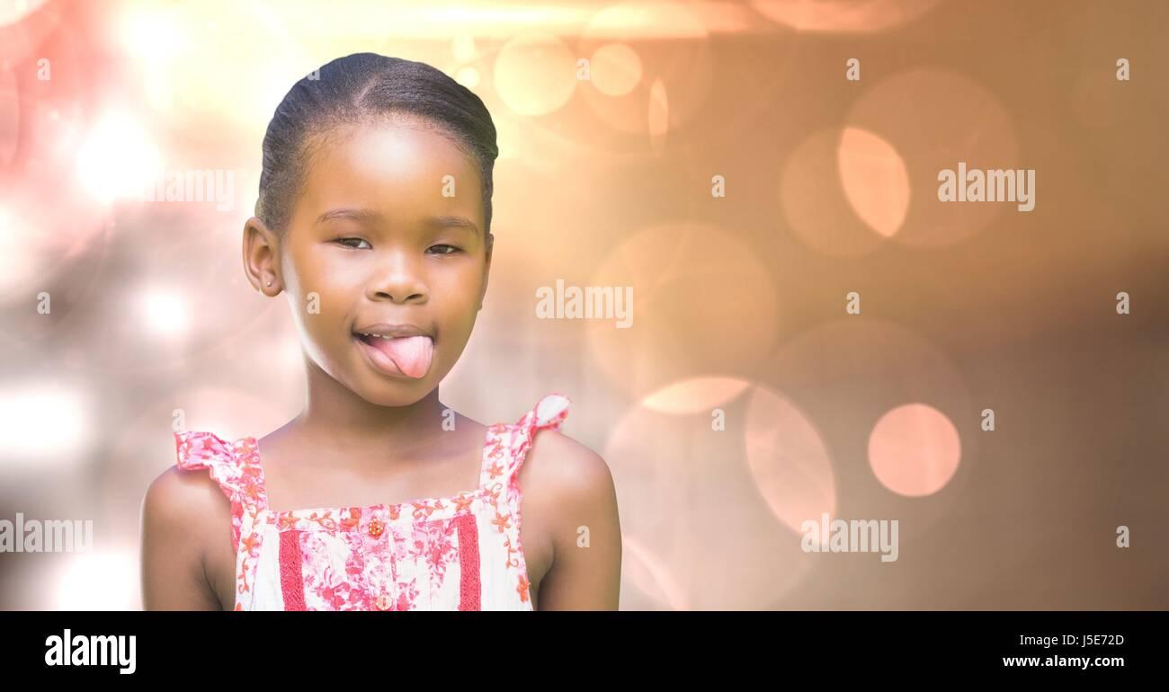 Digital composite of Little girl teasing over bokeh Stock Photo