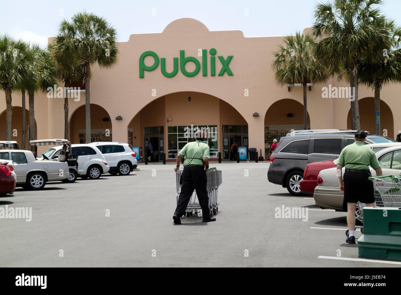 Man pushing trolleys at a Publix supermarket store in central Florida USA April 2017 - Stock Image