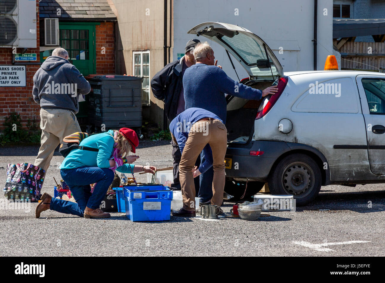 People Browsing Through Items At A Car Boot Sale, Lewes, East Sussex, UK - Stock Image
