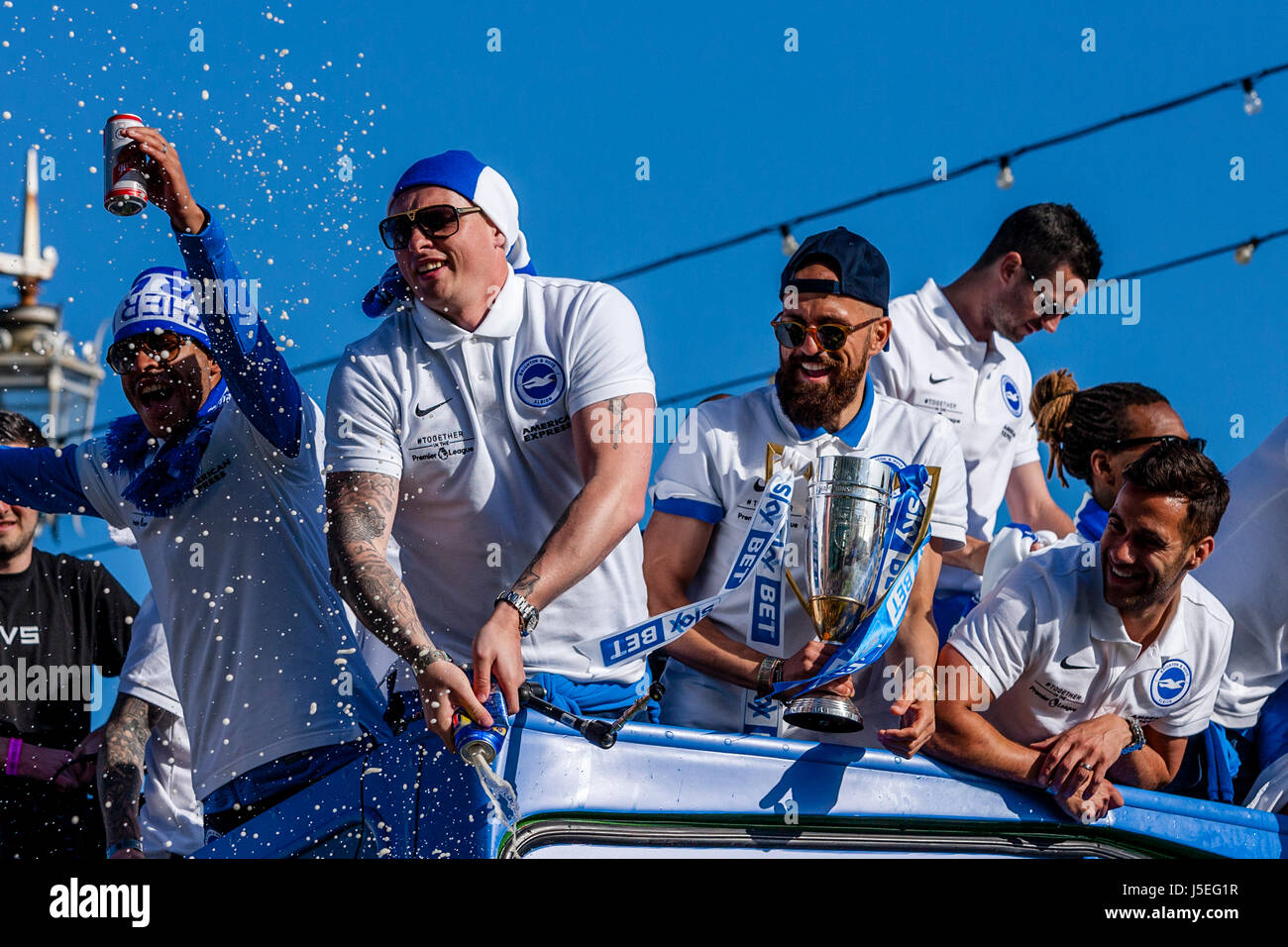 Players From Brighton and Hove Albion FC Take Part In An Open Top Bus Parade Celebrating The Clubs Promotion To - Stock Image